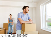 Купить «happy couple with boxes moving to new home», фото № 26885667, снято 4 июня 2017 г. (c) Syda Productions / Фотобанк Лори