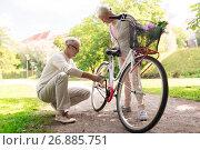 Купить «happy senior couple with bicycle at summer park», фото № 26885751, снято 9 августа 2017 г. (c) Syda Productions / Фотобанк Лори