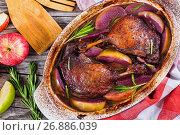 Купить «two roasted duck legs grilled in red wine and apple», фото № 26886039, снято 10 октября 2016 г. (c) Oksana Zh / Фотобанк Лори