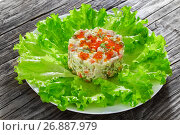 Купить «portion of olivier salad with chopped pickles, sausages and vegetables», фото № 26887979, снято 22 ноября 2018 г. (c) Oksana Zh / Фотобанк Лори