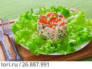 Купить «portion of olivier salad on white plate», фото № 26887991, снято 22 ноября 2018 г. (c) Oksana Zh / Фотобанк Лори