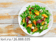 Купить «healthy delicious salad with persimmon slices, top view», фото № 26888035, снято 16 июля 2018 г. (c) Oksana Zh / Фотобанк Лори