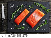 Купить «Raw salmon fillet with fresh rosemary,. salt on slate plate on old dark wooden table with knife, view from above, close-up», фото № 26888279, снято 9 февраля 2017 г. (c) Oksana Zh / Фотобанк Лори