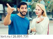 Купить «Man is asking woman stranger about road to hotel», фото № 26891731, снято 10 августа 2017 г. (c) Яков Филимонов / Фотобанк Лори