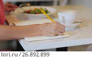 Купить «woman or reviewer rating dish at restaurant», видеоролик № 26892899, снято 23 мая 2019 г. (c) Syda Productions / Фотобанк Лори