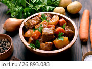 Купить «Meat stew with vegetables in bowl», фото № 26893083, снято 24 января 2017 г. (c) Татьяна Волгутова / Фотобанк Лори