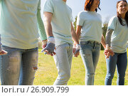 Купить «group of volunteers holding hands in park», фото № 26909799, снято 7 мая 2016 г. (c) Syda Productions / Фотобанк Лори