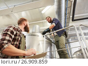 Купить «men with clipboard at brewery or beer plant kettle», фото № 26909859, снято 24 марта 2017 г. (c) Syda Productions / Фотобанк Лори