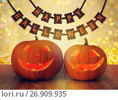 Купить «carved pumpkins and happy halloween garland», фото № 26909935, снято 17 сентября 2014 г. (c) Syda Productions / Фотобанк Лори