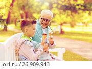 Купить «old man and boy eating ice cream at summer park», фото № 26909943, снято 9 июля 2016 г. (c) Syda Productions / Фотобанк Лори