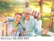 Купить «old man and boy taking selfie by smartphone», фото № 26909947, снято 9 июля 2016 г. (c) Syda Productions / Фотобанк Лори