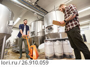 Купить «men with beer kegs and clipboard at craft brewery», фото № 26910059, снято 24 марта 2017 г. (c) Syda Productions / Фотобанк Лори