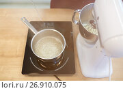 Купить «electric mixer and pot on stove at kitchen», фото № 26910075, снято 8 мая 2017 г. (c) Syda Productions / Фотобанк Лори
