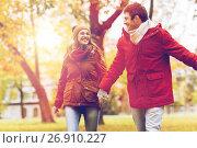 Купить «happy young couple walking in autumn park», фото № 26910227, снято 9 октября 2016 г. (c) Syda Productions / Фотобанк Лори