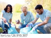 Купить «volunteers with garbage bags cleaning park area», фото № 26910307, снято 7 мая 2016 г. (c) Syda Productions / Фотобанк Лори