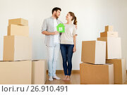 Купить «happy couple with boxes moving to new home», фото № 26910491, снято 4 июня 2017 г. (c) Syda Productions / Фотобанк Лори