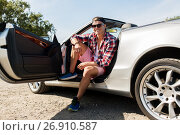 happy young man sitting in convertible car, фото № 26910587, снято 27 июля 2017 г. (c) Syda Productions / Фотобанк Лори
