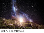 Купить «rocky landscape over night sky or space», фото № 26910663, снято 25 июня 2016 г. (c) Syda Productions / Фотобанк Лори