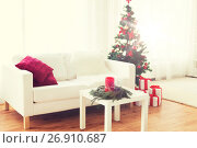 Купить «sofa, table and christmas tree with gifts at home», фото № 26910687, снято 7 октября 2015 г. (c) Syda Productions / Фотобанк Лори