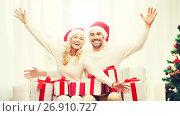 Купить «happy couple at home with christmas gift boxes», фото № 26910727, снято 8 октября 2015 г. (c) Syda Productions / Фотобанк Лори