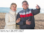 Купить «Smiling husband points to something interesting», фото № 26911827, снято 24 января 2019 г. (c) Яков Филимонов / Фотобанк Лори