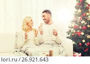 Купить «happy couple at home with christmas tree», фото № 26921643, снято 8 октября 2015 г. (c) Syda Productions / Фотобанк Лори
