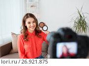 Купить «woman with bronzer and camera recording video», фото № 26921875, снято 22 декабря 2016 г. (c) Syda Productions / Фотобанк Лори