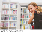 Купить «Disabled girl in wheelchair in school library», фото № 26922791, снято 18 октября 2018 г. (c) Wavebreak Media / Фотобанк Лори