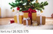 Купить «hands taking gift boxes from under christmas tree», видеоролик № 26923175, снято 11 сентября 2017 г. (c) Syda Productions / Фотобанк Лори
