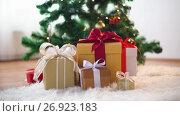 Купить «hands putting gift boxes under christmas tree», видеоролик № 26923183, снято 9 сентября 2017 г. (c) Syda Productions / Фотобанк Лори