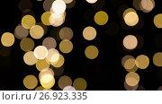 Купить «blurred chtistmas lights over dark background», видеоролик № 26923335, снято 9 сентября 2017 г. (c) Syda Productions / Фотобанк Лори