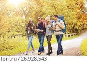 Купить «group of smiling friends with backpacks hiking», фото № 26928543, снято 31 августа 2014 г. (c) Syda Productions / Фотобанк Лори