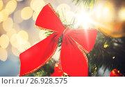 Купить «close up of red bow decoration on christmas tree», фото № 26928575, снято 7 октября 2015 г. (c) Syda Productions / Фотобанк Лори