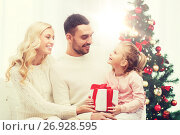 Купить «happy family at home with christmas tree», фото № 26928595, снято 8 октября 2015 г. (c) Syda Productions / Фотобанк Лори
