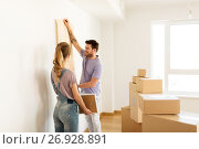 Купить «happy couple with boxes moving to new home», фото № 26928891, снято 4 июня 2017 г. (c) Syda Productions / Фотобанк Лори