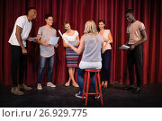 Купить «Actors reading their scripts on stage», фото № 26929775, снято 20 апреля 2017 г. (c) Wavebreak Media / Фотобанк Лори