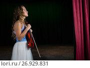 Купить «Thoughtful woman with violin standing on stage», фото № 26929831, снято 20 апреля 2017 г. (c) Wavebreak Media / Фотобанк Лори