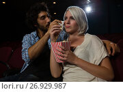 Купить «Couple getting emotional while watching movie», фото № 26929987, снято 20 апреля 2017 г. (c) Wavebreak Media / Фотобанк Лори