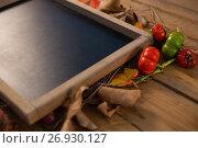 Купить «Close up of writing slate amidst dry leaves and tomato», фото № 26930127, снято 11 апреля 2017 г. (c) Wavebreak Media / Фотобанк Лори