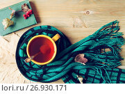 Купить «Autumn background - cup of tea, old book and warm scarf on the wooden background. Autumn still life. Still life with concept of spending autumn time at cozy home», фото № 26930171, снято 8 сентября 2017 г. (c) Зезелина Марина / Фотобанк Лори
