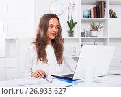 Купить «portrait of woman working on computer at firm office», фото № 26933627, снято 17 сентября 2019 г. (c) Яков Филимонов / Фотобанк Лори