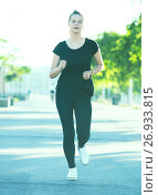 Купить «Girl enjoying morning run outdoors», фото № 26933815, снято 5 июля 2017 г. (c) Яков Филимонов / Фотобанк Лори