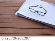 Купить «Close-up of spectacles on blank paper», фото № 26935287, снято 26 мая 2017 г. (c) Wavebreak Media / Фотобанк Лори