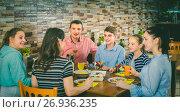 Купить «Group of adults and teenagers spending time in cafe», фото № 26936235, снято 10 апреля 2017 г. (c) Яков Филимонов / Фотобанк Лори