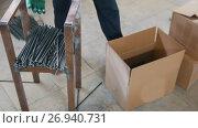 Купить «Fiberglass kernels - worker packs production in box on warehouse», видеоролик № 26940731, снято 18 января 2020 г. (c) Константин Шишкин / Фотобанк Лори