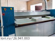 Купить «Automatic laundry ironing line», фото № 26941003, снято 14 сентября 2017 г. (c) Евгений Ткачёв / Фотобанк Лори