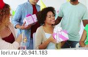 Купить «team greeting colleague at office birthday party», видеоролик № 26941183, снято 6 сентября 2017 г. (c) Syda Productions / Фотобанк Лори
