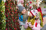 Female customers staring at counter of Christmas market, фото № 26950419, снято 18 сентября 2017 г. (c) Яков Филимонов / Фотобанк Лори