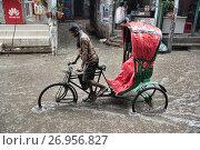 Купить «Rickshaw in the monsoon, Dhaka, Bangladesh.», фото № 26956827, снято 10 июля 2017 г. (c) age Fotostock / Фотобанк Лори