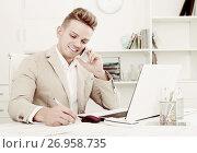 Купить «businessman negotiating on mobile phone», фото № 26958735, снято 21 сентября 2018 г. (c) Яков Филимонов / Фотобанк Лори